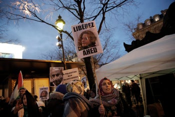 """File photo: Demonstrators hold posters reading: """"Release Ahed"""" during a protest demanding Israel to release Palestinian teenager Ahed Tamimi, in Paris, Thursday Jan. 4, 2018."""
