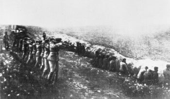 This photo was taken from a the body of a dead Germany officer killed in Russia, showing a German firing squad shooting Soviet civilians in the back as they sit beside their own mass grave, in Babi Yar, Kiev, 1942.