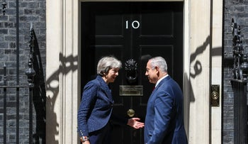 Theresa May, U.K. prime minister, left, greets Benjamin Netanyahu, Israel's prime minister, ahead of their meeting at number 10 Downing Street on June 6, 2018.