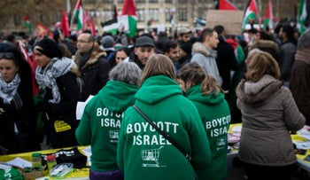 Demonstrators wear shirts reading 'Boycott Israel' during a protest against U.S. President Donald Trump's decision to recognize Jerusalem as Israel's capital, Paris, France, December 9, 2017.