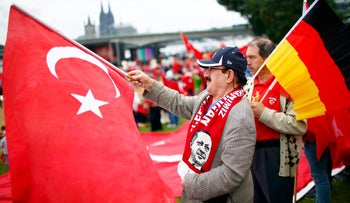 Supporters of Turkish President Tayyip Erdogan wave Turkish flags during a pro-government protest in Cologne, Germany July 31, 2016