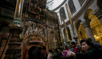 Christian pilgrims from Indonesia visiting the Church of the Holy Sepulchre, traditional site of Jesus' crucifixion and tomb,  in Jerusalem's Old City, 2015