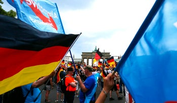 Supporters of the far-right anti-immigration party Alternative for Germany (AfD) attend a protest in Berlin, Germany. May 27, 2018