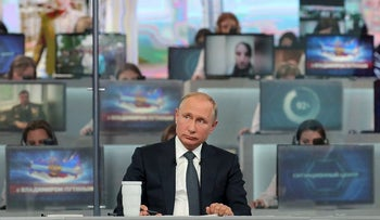 Russian President Vladimir Putin attends a live nationwide broadcast call-in in Moscow, Russia June 7, 2018