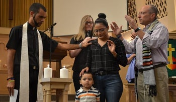 El Salvadorian refugee Araceli Velasquez being welcomed into the Park Hill United Methodist and Temple Micah community in 2017, with Rabbi Adam Morris on the right.