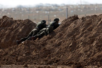 Israeli soldiers are seen on the Israeli side of the border fence between Israel and the Gaza Strip May 15, 2018.