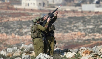 Israeli soldiers firing tear gas during clashes with Palestinian protesters near Nablus.
