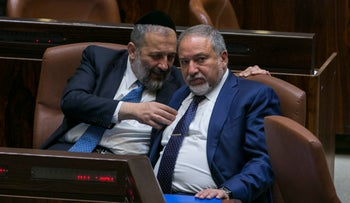 Interior Minister Arye Dery and Defense Minister Avigdor Lieberman in the Knesset, 2017.