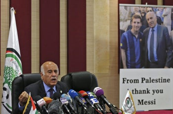 """Jibril Rajoub, the head of the Palestinian Football Association, speaks during during a press conference in the West Bank city of Ramallah on June 6, 2018. Israel lashed out today at Argentina's national football team over the cancellation of a pre-World Cup friendly in Jerusalem, as Palestinians celebrated the decision after protesting the game. The Israeli embassy in Argentina on Tuesday announced the """"suspension"""" of Saturday's match with its national team, citing what it called """"threats and provocations"""" against Barcelona superstar Lionel Messi. / AFP PHOTO / ABBAS MOMANI"""