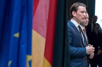 Austria's Chancellor Sebastian Kurz (L) stands next to Manfred Weber of Germany's conservative CSU party as he gives a statement during a meeting of the European Parliament's faction of the European People's Party (EPP) in Munich, southern Germany, on June 7, 2018. / AFP PHOTO / dpa / Peter Kneffel / Germany OUT