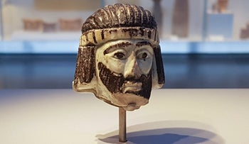 Photo taken June 4, 2018 of a detailed figurine of a royal head on display at the Israel Museum, dating to biblical times, and found last year near Israel's northern border with Lebanon, in Jerusalem.