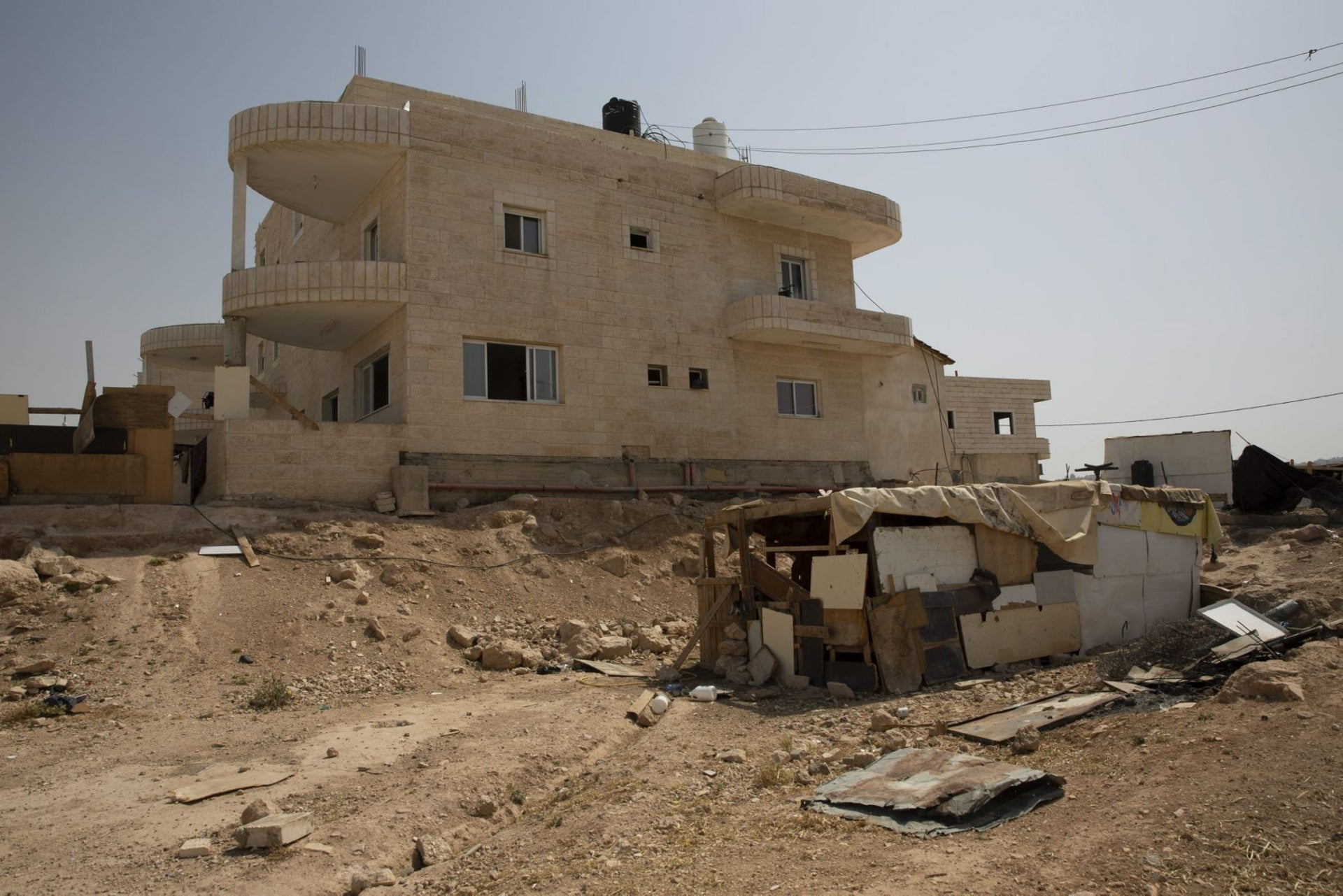 Plots leased to the Bedouin at al-Jabal in the West Bank. From outside, the houses look like villas, but not inside, May 27, 2018.