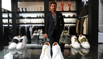Daniel Essa posing with his sneakers in Lille.