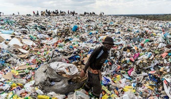 A recycler drags a huge bag of paper sorted for recycling at Richmond sanitary landfill on June 2, 2018.