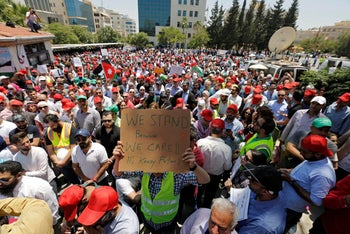 Protesters are seen gathered in front of the Labour Union offices in Amman, Jordan, June 6, 2018.