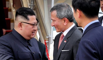 North Korean leader Kim Jong Un is greeted by Singapore Minister for Foreign Affairs Dr. Vivian Balakrishnan at the Changi International Airport, June 10, 2018.