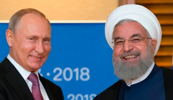 Putin meets Rohani on the sidelines of the Shanghai Cooperation Organisation Summit in Qingdao, June 9, 2018.