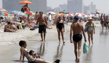 New Yorkers cooling off at the beach in Coney Island, Brooklyn. A new plan would make one of the area's beaches gender-segregated for two days this summer.