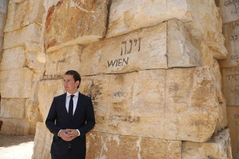 Austrian Chancellor Sebastian Kurz is shown against a stone wall with the word VIEN engraved on it. at Yad Vashem World Holocaust Remembrance Center in Jerusalem. June 10, 2018.
