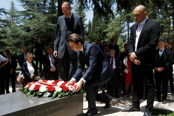 Austrian Chancellor Sebastian Kurz lays a wreath on the grave of the late Israeli President Shimon Peres at the Mount Herzl cemetery in Jerusalem on June 10, 2018.