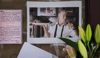 Photographs and flowers left in memory of Anthony Bourdain at the Brasserie Les Halles, where Bourdain used to work, June 8, 2018.