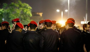Jordanian security forces ahead of a demonstration against an income-tax bill, Amman, June 6, 2018.