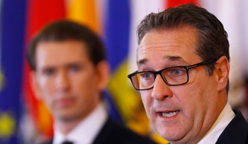 Kurz and Strache address a news conference after a cabinet meeting in Vienna, Austria, March 14, 2018.