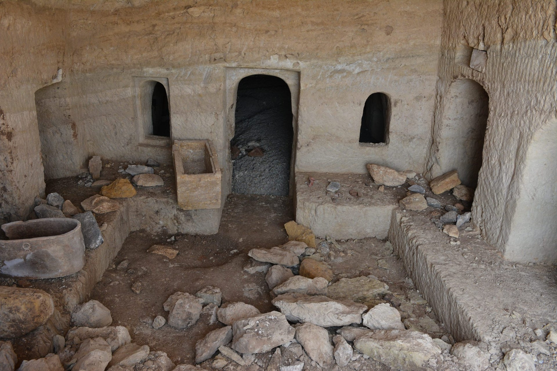 Inside the 2,000-year-old Jewish burial cave found in Tiberias: Room for a family. On the left is an ossuary.