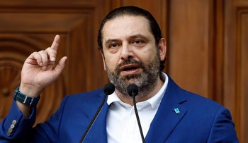 Lebanese Prime Minister Saad Hariri speaks to his supporters after his bloc won 21 seats in the parliamentary elections, May 11, 2018.