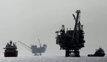 Israeli gas platforms, controlled by U.S.-Israeli energy group Noble and Delek, are seen in the Mediterranean sea, some 15 miles (24 km) west of Israel's port city of Ashdod, in this file picture taken February 25, 2013.