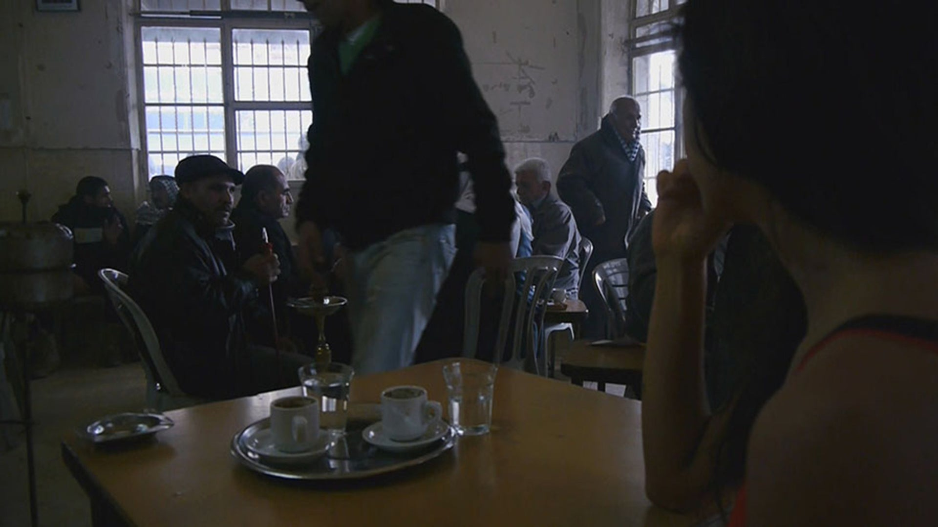 """Men in a cafe. Scene from """"The Men Behind the Wall."""""""