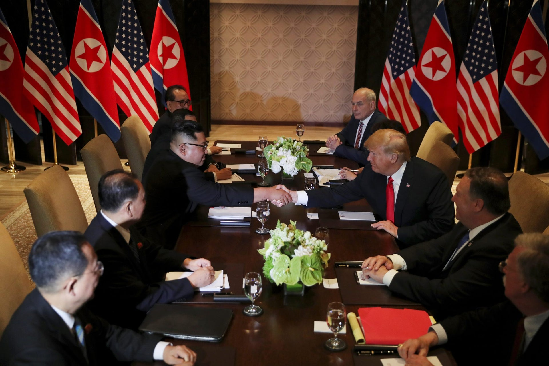 Thrice lucky: Kim and Trump pose for a third handshake during negotiations. Sentosa, Singapore, 12 June 2018