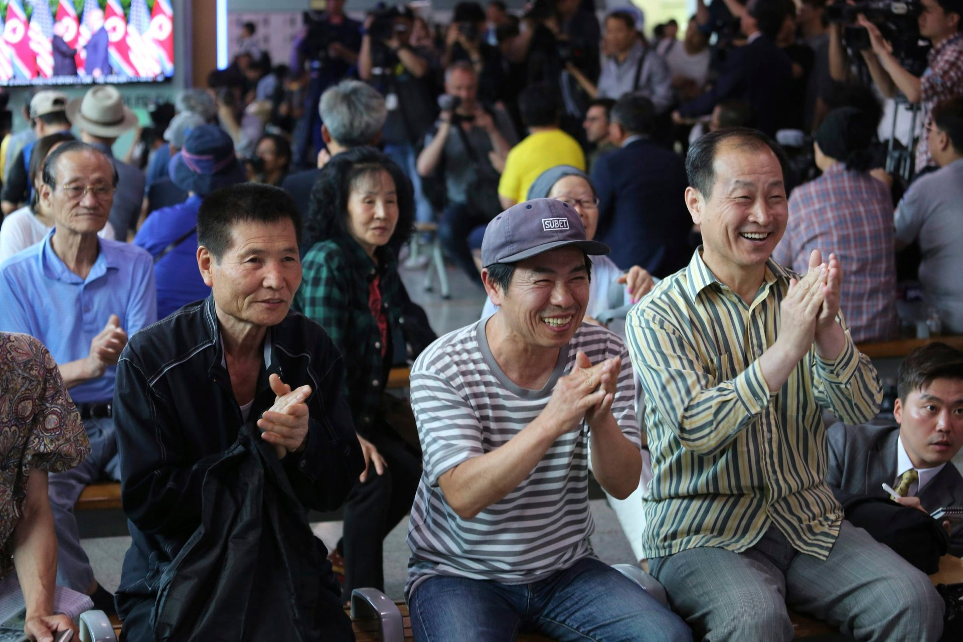 Smiles all around: people watch the summit from Seoul, South Korea, June 12 2018