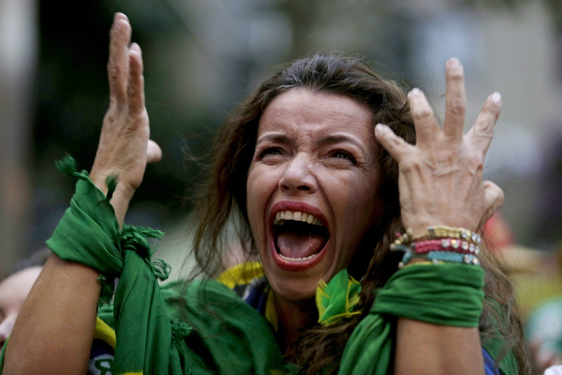 A Brazil soccer fan screaming as Germany defeats her team 7-1 in a semifinal World Cup match, July 2014.