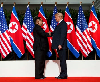 North Korean leader Kim Jong Un, left, and U.S. President Donald Trump shaking hands prior to their meeting in Singapore, June 12, 2018.