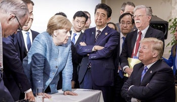 Merkel, Japanese Prime Minister Shinzo Abe, U.S. National Security Adviser John Bolton and U.S. President Donald Trump at the G7 summit