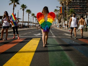 People taking part in the gay pride parade in Tel Aviv on June 8, 2018.
