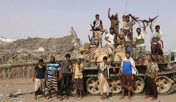 Tribal fighters loyal to the Yemeni government stand by a tank in al-Faza area near Hodeida, Yemen June 1, 2018. Picture taken June 1, 2018