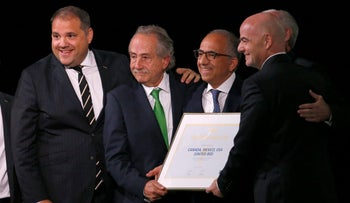 Delegates of Canada, Mexico and the United States celebrating with FIFA President Gianni Infantino, right, after winning a joint bid to host the 2026 World Cup, at the FIFA congress in Moscow, June 13, 2018.