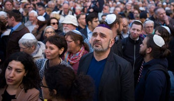 People wear skullcaps during a demonstration against anti-Semitism in Berlin, Germany, April 25, 2018.