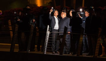 Supreme Leader Kim Jong Un, center right, stands for a selfie with Vivian Balakrishnan, Singapore's foreign affairs minister, while touring the Esplanade in Singapore on Monday, June 11, 2018.