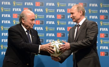 President Sepp Blatter and Russian President Vladimir Putin hold a soccer ball during the official ceremony of handover to Russia as the 2018 World Cup hosts, 2014