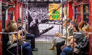 Commuters ride a World Cup themed metro car decorated with a picture of Soviet goalkeeper Lev Yashin in Moscow on June 13, 2018