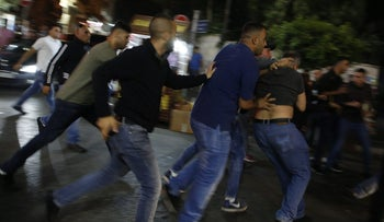 Palestinian security forces break up a protest in Ramallah on Wednesday against President Mahmoud Abbas's financial sanctions on Gaza.
