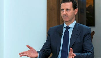 In this photo released on Sunday, June 10, 2018 by the Syrian official news agency SANA, Syrian President Bashar Assad speaks during an interview with the Daily Mail, in Damascus