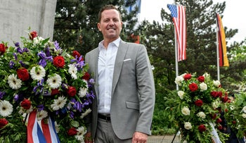FILE PHOTO: U.S. ambassador to Germany Richard Allen Grenell stands beside a wreath in Berlin, Germany, May 12, 2018.
