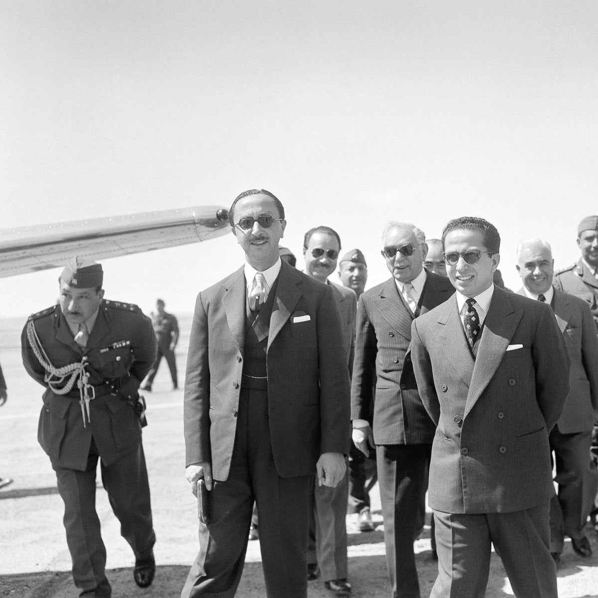 Foreground, from left: Iraq's regent Abd al-Ilah and King Faisal II, with Prime Minister Nuri Sa'id (between them).