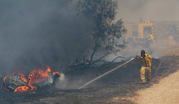 Fire extinguishing forces in the area of Kibbutz Be'eri this week.