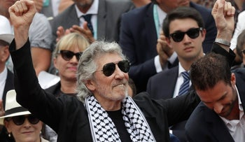 Roger Waters presents the trophy of the men's final match of the French Open tennis tournament in Paris, June 10, 2018.