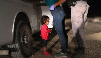 A two-year-old Honduran asylum seeker cries as her mother is searched and detained near the U.S.-Mexico border, McAllen, Texas, June 12, 2018.
